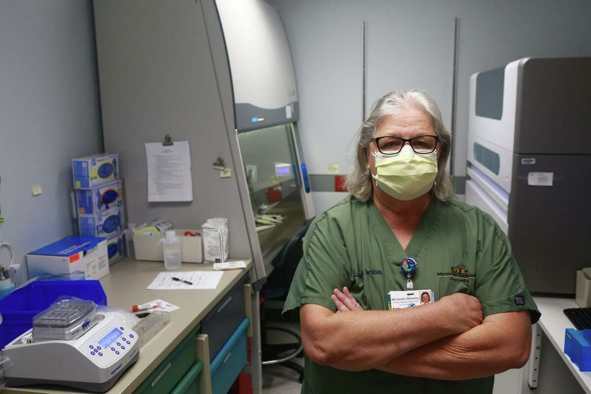 Lab manager Pattie Hudak poses in a testing room at Methodist Healthcare System. The 35-year Methodist employee, says she hasn't seen anything quite like what's happening with the coronavirus pandemic.