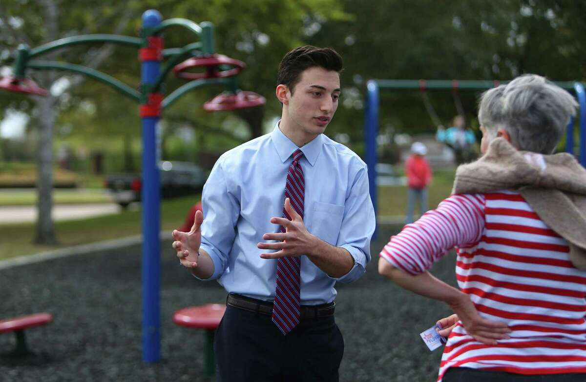 Mike Floyd, an 18-year-old senior at Dawson High School, speaks to a potential voter about his run for the Pearland Independent School District's Board of Trustees, Wednesday, March 15, 2017, at Silverlake Park in Pearland. Floyd, who has worked and interned with several campaigns in Fort Bend and Brazoria counties, says he thinks the school board needs to do more to provide unconditional support for the district's students. ( Mark Mulligan / Houston Chronicle )