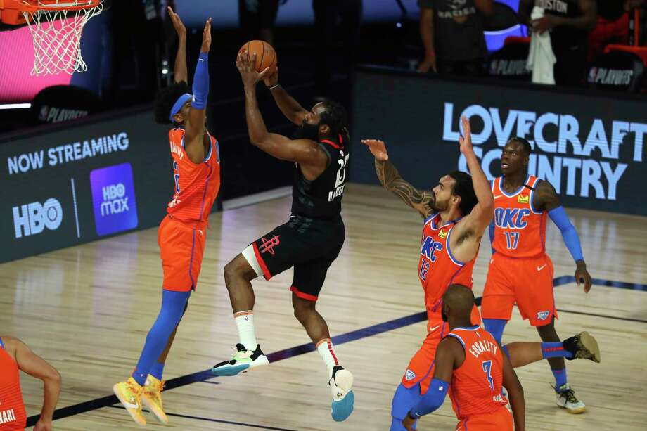 PHOTOS: More from the Rockets' big Game 1 win Houston Rockets guard James Harden, center, shoots against Oklahoma City Thunder center Steven Adams, right, and guard Shai Gilgeous-Alexander, left, in the first half of Game 1 of an NBA basketball first-round playoff series, Tuesday, Aug. 18, 2020, in Lake Buena Vista, Fla. (Kim Klement/Pool Photo via AP) Photo: Kim Klement, Associated Press / Kim Klement