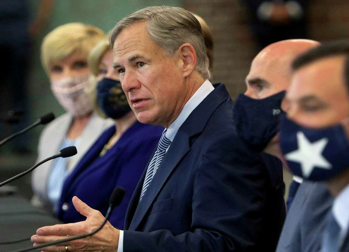 Texas Governor Greg Abbott announces a legislative proposal that would discourage cities from defunding the police on Tuesday, August 18, 2020, in Fort Worth. Abbott, Lt. Gov. Dan Patrick and Speaker Dennis Bonnen proposed legislation that would freeze a city's property tax revenue if that city defunded its police department. (Amanda McCoy/Fort Worth Star-Telegram)