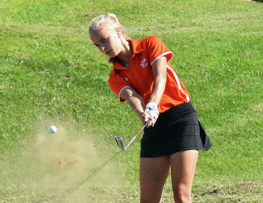 Edwardsville's Sydney Weedman hits a shot out of the bunker on No. 4 at Legacy Golf Course in Granite City on Tuesday. Photo: Matt Kamp|The Intelligencer