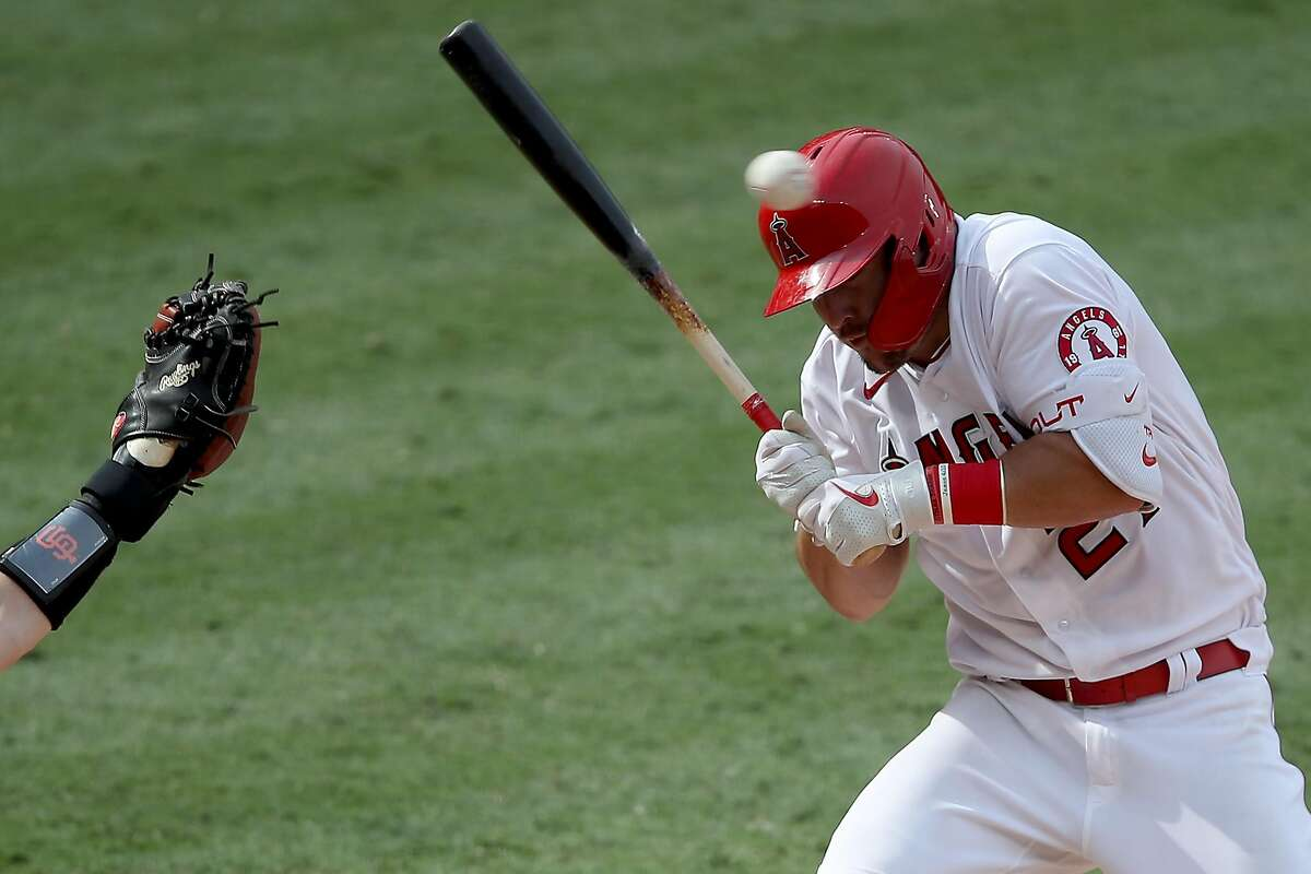 ANAHEIM, CALIFORNIA - AUGUST 18: Mike Trout #27 of the Los Angeles Angels ducks a high pitch by Shaun Anderson #64 of the San Francisco Giants during the ninth inning of a game at Angel Stadium of Anaheim on August 18, 2020 in Anaheim, California. (Photo by Sean M. Haffey/Getty Images)