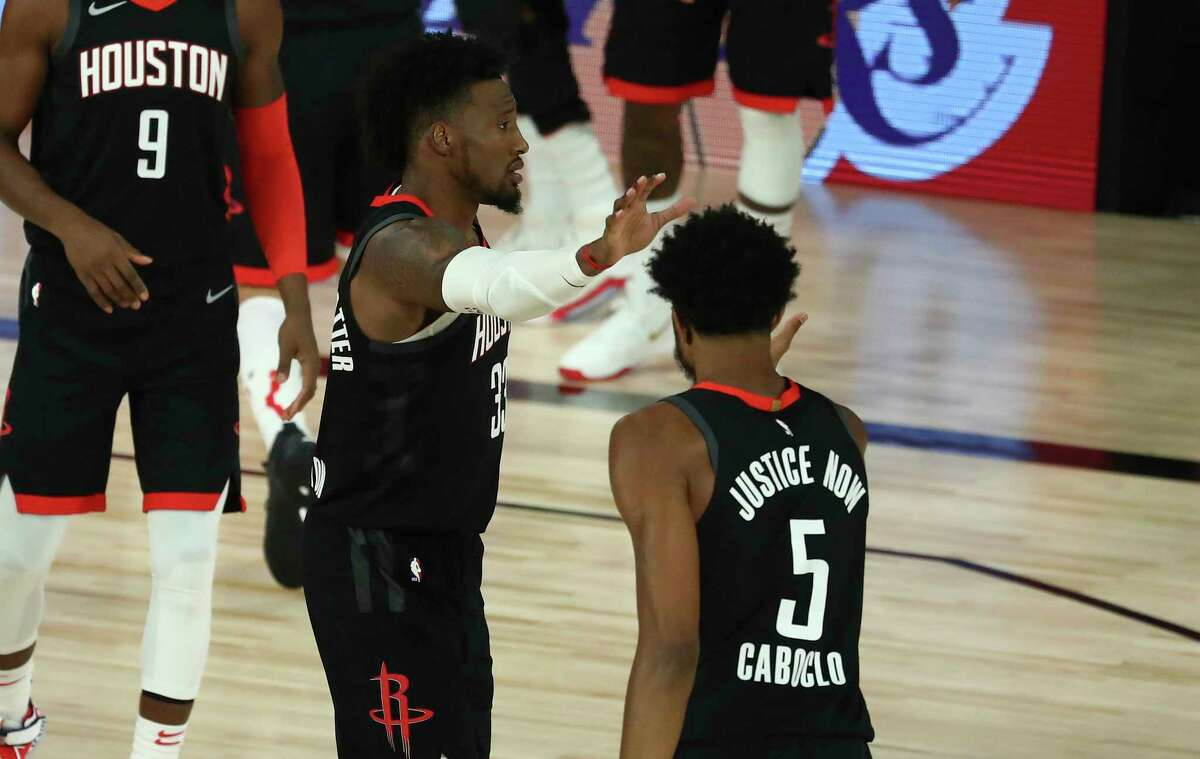 Houston Rockets forward Robert Covington (33) and forward Bruno Caboclo (5) celebrate after defeating the Oklahoma City Thunder in Game 1 of an NBA basketball first-round playoff series, Tuesday, Aug. 18, 2020, in Lake Buena Vista, Fla. (Kim Klement/Pool Photo via AP)