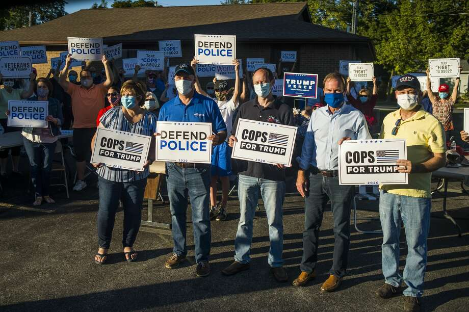 Dozens of people gather for a Cops for Trump MAGA Meet-Up Tuesday, Aug. 18, 2020 on Ashman Street in Midland. (Katy Kildee/kkildee@mdn.net) Photo: (Katy Kildee/kkildee@mdn.net)