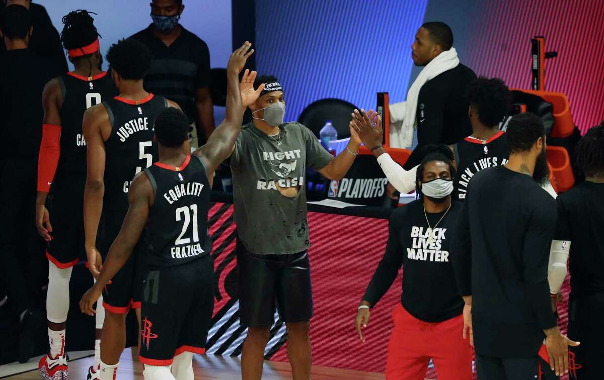 Houston Rockets point guard Russell Westbrook celebrates with teammates after the Rockets defeated the Oklahoma City Thunder in Game 1 of an NBA basketball first-round playoff series, Tuesday, Aug. 18, 2020, in Lake Buena Vista, Fla. (Kim Klement/Pool Photo via AP)