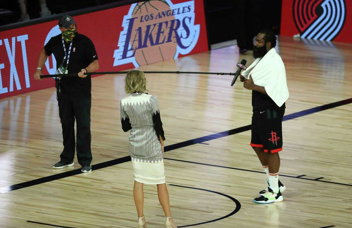 Houston Rockets guard James Harden (13) is interviewed after the Rockets defeated the Oklahoma City Thunder in Game 1 of an NBA basketball first-round playoff series, Tuesday, Aug. 18, 2020, in Lake Buena Vista, Fla. (Kim Klement/Pool Photo via AP)
