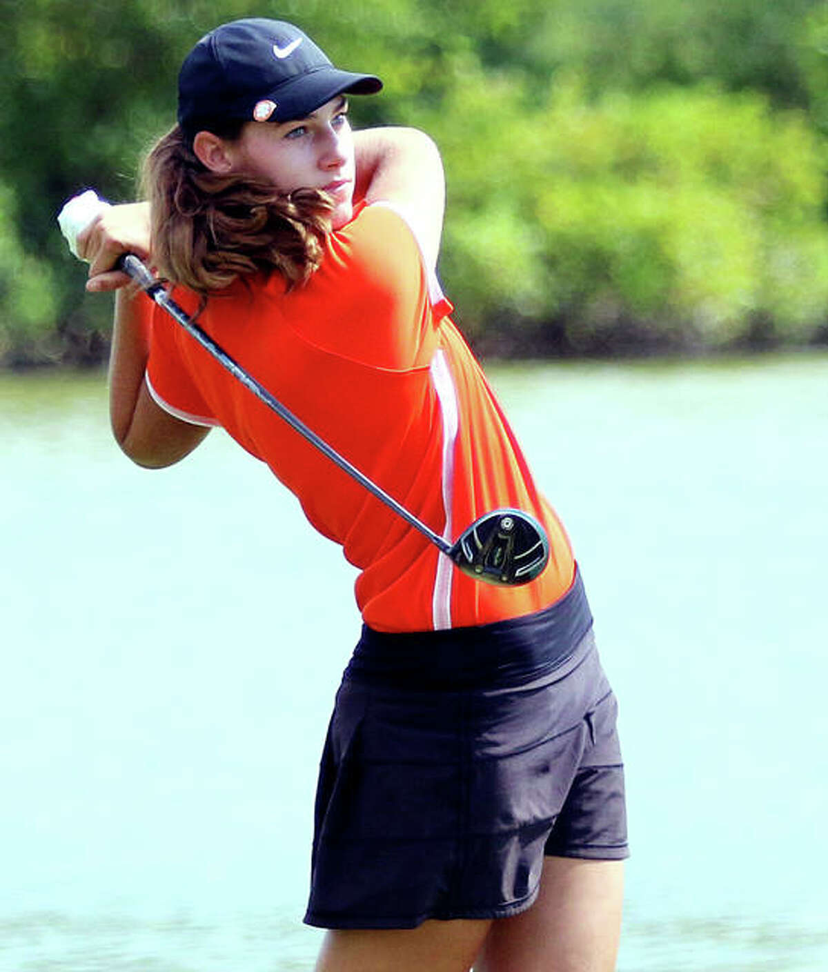 Edwardsville sophomore Nicole Johnson watches her drive to start her second nine on hole No. 1 Tuesday at the Madison County Tourney at The Legacy in Granite City. Johnson, the defending county champion, shot 73.