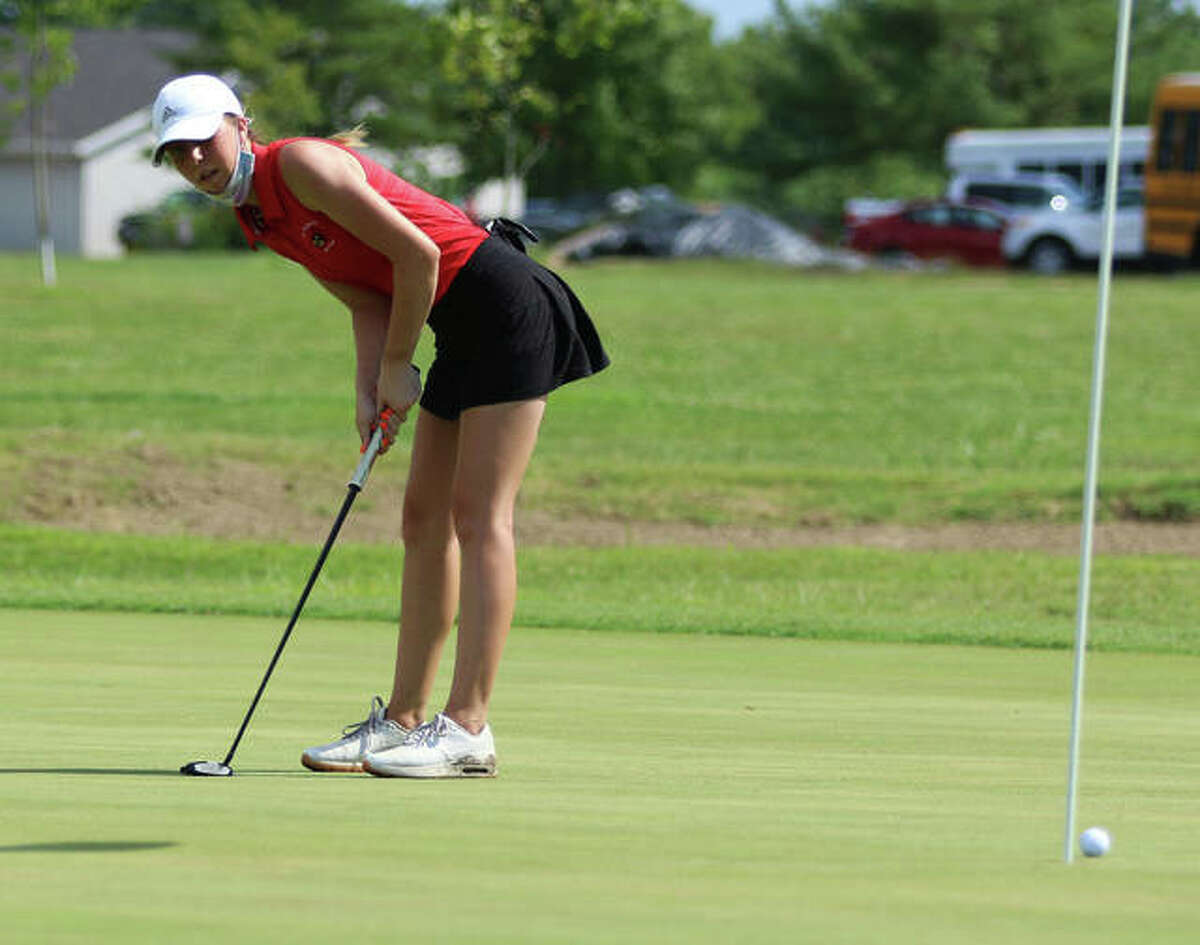 Alton's Natalie Messinger reacts after narrowly missing a putt Tuesday at the Madison County Tourney at The Legacy in Granite City.