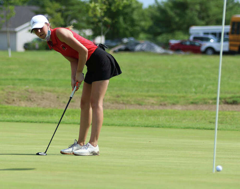 Alton's Natalie Messinger reacts after narrowly missing a putt Tuesday at the Madison County Tourney at The Legacy in Granite City. Photo: Greg Shashack / The Telegraph