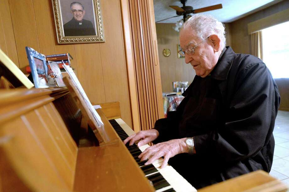 Fr. Luis Urriza plays piano in the rectory he calls home. At 99, Fr. Urriza is the oldest priest in the Diocese of Beaumont. Fr. Urriza founded Cristo Rey Church in Beaumont, located in one of the city's most heavily Hispanic communities. The native of Lerin, Spain applauded when Bishop-elect Fr. David Toups spoke in Spanish during a portion of his speech to those assembled for his introduction as the next Bishop of the Beaumont Diocese. Photo taken Friday, August 14, 2020 Kim Brent/The Enterprise Photo: Kim Brent / The Enterprise / BEN