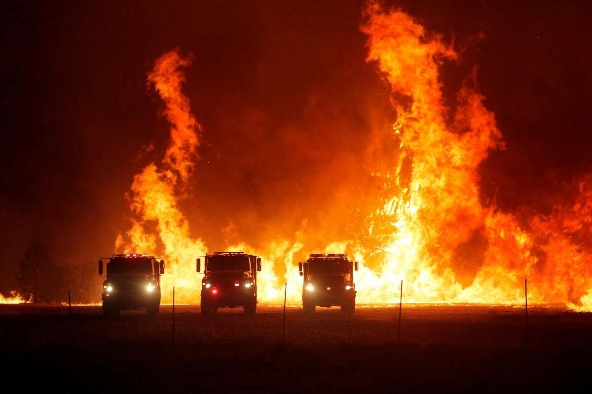 CalFire crews stage in a gravel parking lot above Lake Berryessa while fighting the LNU Lightning Complex Fire near Lake Berryessa, Calif., on Tuesday, August 18, 2020.