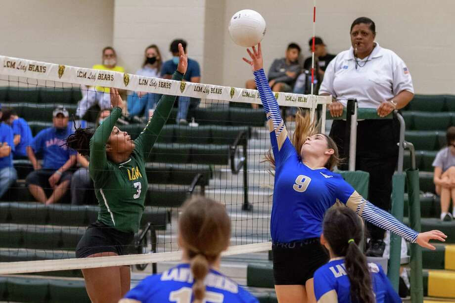 Kylea Buchanan (9) of the Lady Horns puts one over the net in the late going as the Lady Bears of Little Cypress-Mauriceville took down the Lady Horns of Hamshire-Fannett on Tuesday night. Photo made on August 18, 2020.  Fran Ruchalski/The Enterprise Photo: Fran Ruchalski, The Enterprise / The Enterprise / © 2020 The Beaumont Enterprise