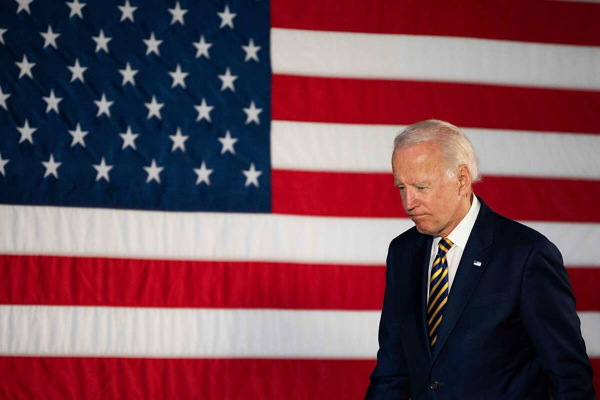 """(FILES) In this file photo taken on June 17, 2020 Democratic presidential candidate Joe Biden departs after speaking about reopening the country during a speech in Darby, Pennsylvania. - Joe Biden will not attend the Democratic convention to accept the party's nomination to be its presidential election candidate after the event was further scaled back due to the coronavirus pandemic, officials said August 5, 2020. Biden """"will no longer travel to Milwaukee and will instead address the nation and accept the Democratic nomination from his home state of Delaware,"""" the party said in a statement, announcing that no speakers would physically attend the August 17-20 convention. (Photo by JIM WATSON / AFP) (Photo by JIM WATSON/AFP via Getty Images)"""