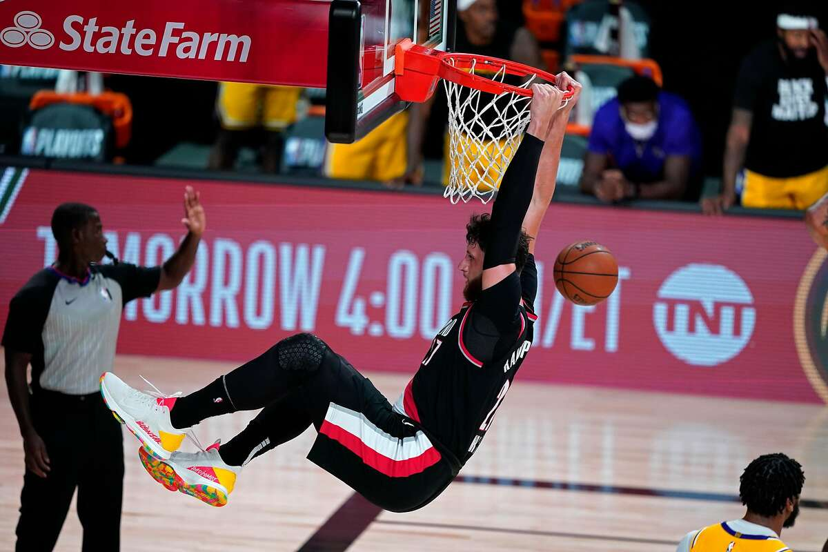 LAKE BUENA VISTA, FLORIDA - AUGUST 18: Jusuf Nurkic #27 of the Portland Trail Blazers slam dunks against the Los Angeles Lakers during the second half in Game 1 of Round 1 of the NBA Playoffs at AdventHealth Arena at ESPN Wide World Of Sports Complex on August 18, 2020 in Lake Buena Vista, Florida. NOTE TO USER: User expressly acknowledges and agrees that, by downloading and or using this photograph, User is consenting to the terms and conditions of the Getty Images License Agreement. (Photo by Ashley Landis-Pool/Getty Images)