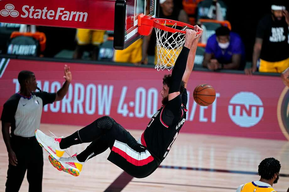 LAKE BUENA VISTA, FLORIDA - AUGUST 18:  Jusuf Nurkic #27 of the Portland Trail Blazers slam dunks against the Los Angeles Lakers during the second half in Game 1 of Round 1 of the NBA Playoffs at AdventHealth Arena at ESPN Wide World Of Sports Complex on August 18, 2020 in Lake Buena Vista, Florida. NOTE TO USER: User expressly acknowledges and agrees that, by downloading and or using this photograph, User is consenting to the terms and conditions of the Getty Images License Agreement. (Photo by Ashley Landis-Pool/Getty Images) Photo: Pool / Getty Images