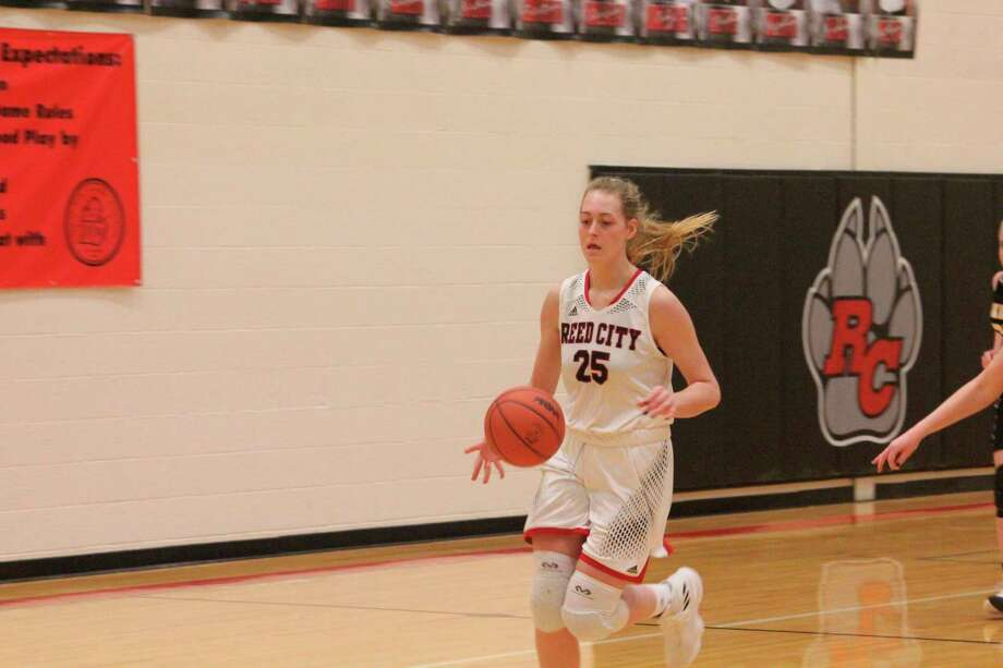 Reed City's Alison Duddles dribbles down the court during her Coyote basketball career. (Herald Review file photo)