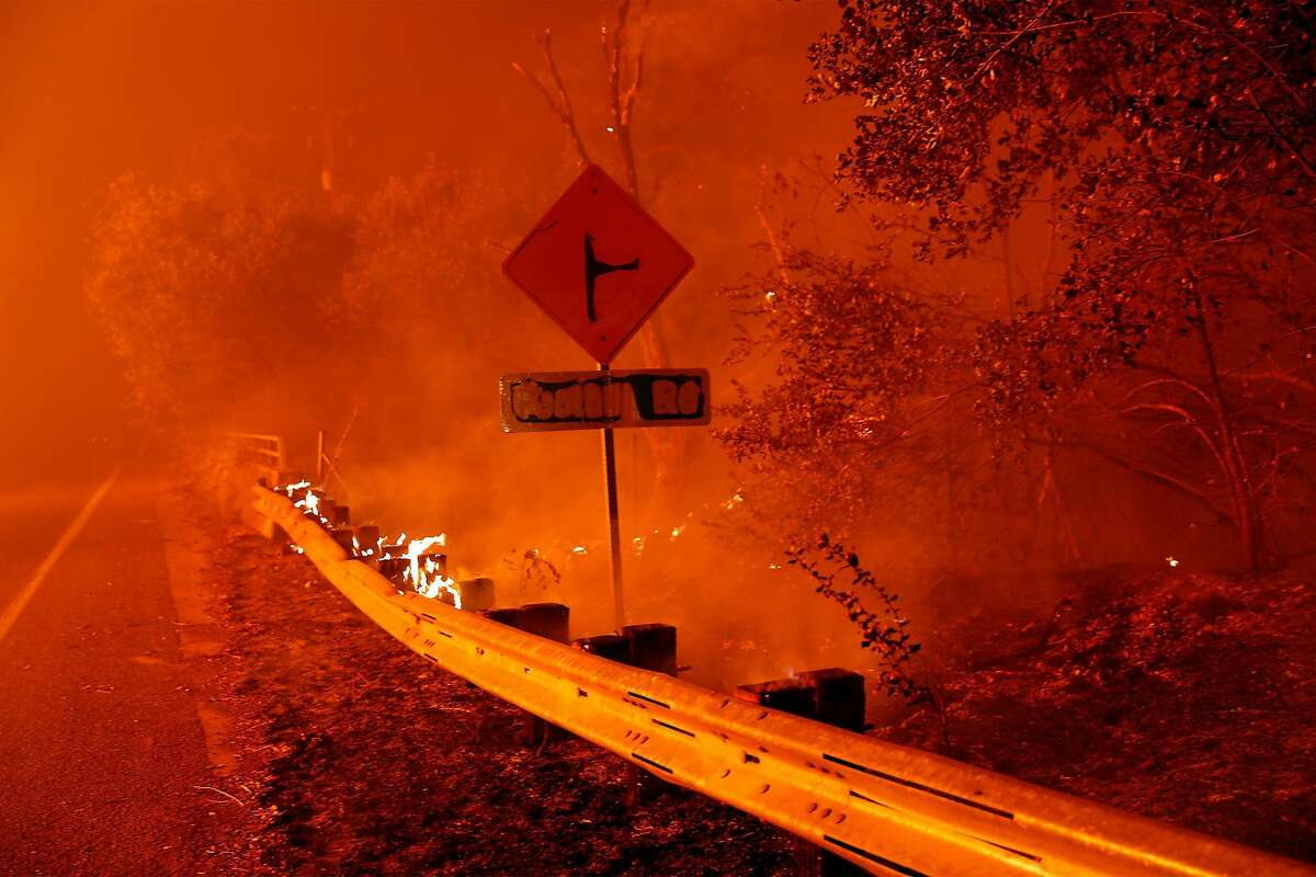 A burned road sign along Pleasant Valley Road during LNU Lightning Complex Fire in Vacaville , Calif., on Wednesday, August 19, 2020.