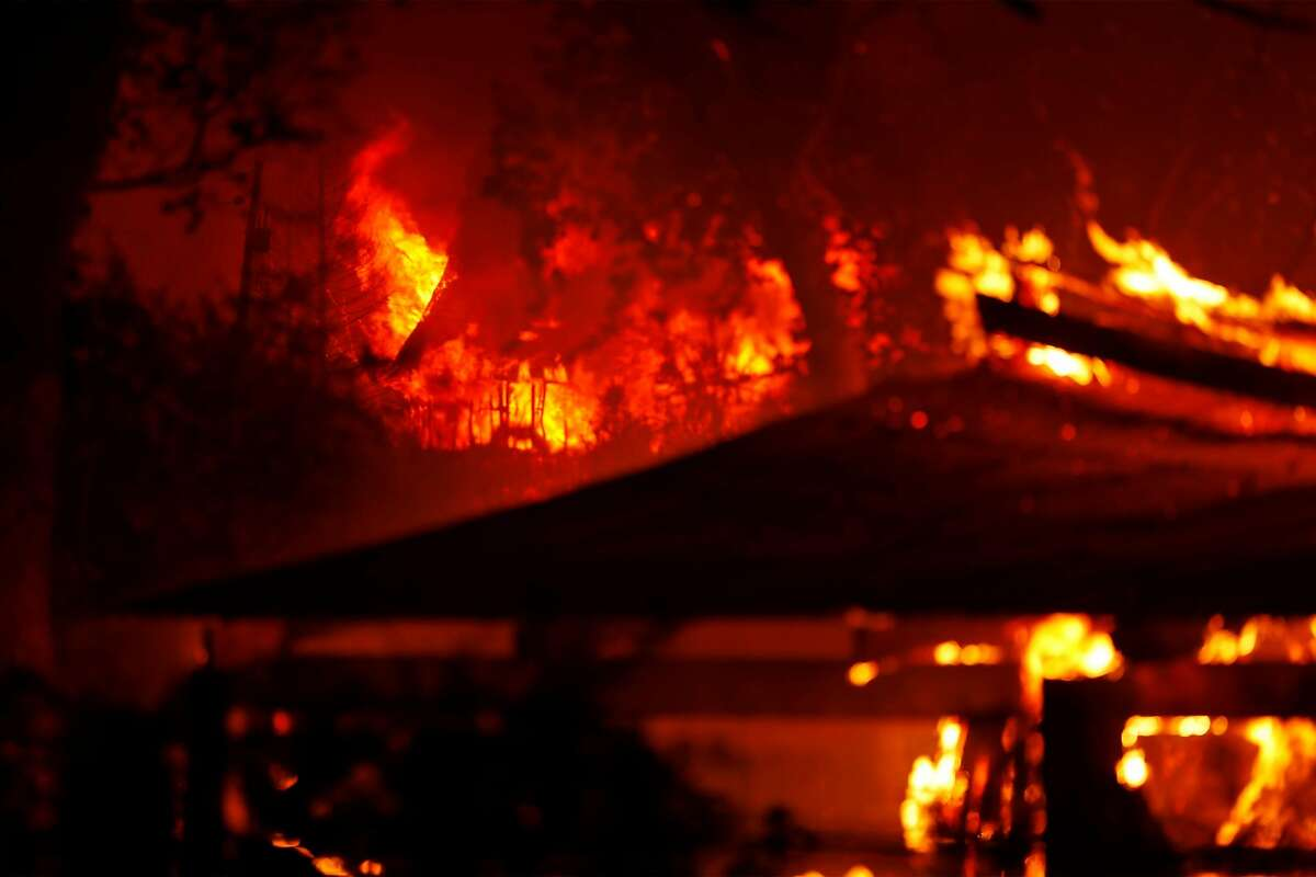 Structures are engulfed in flames along Pleasant Valley Road during LNU Lightning Complex Fire in Vacaville , Calif., on Wednesday, August 19, 2020.