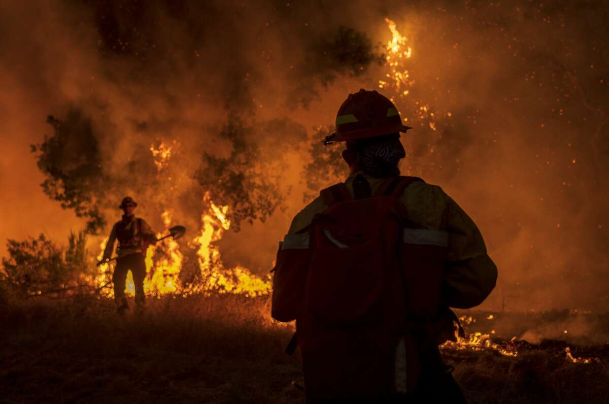 Members of the Grizzly Firefighters fight the Carmel Fire near Carmel Valley, Calif., Tuesday, Aug. 18, 2020.