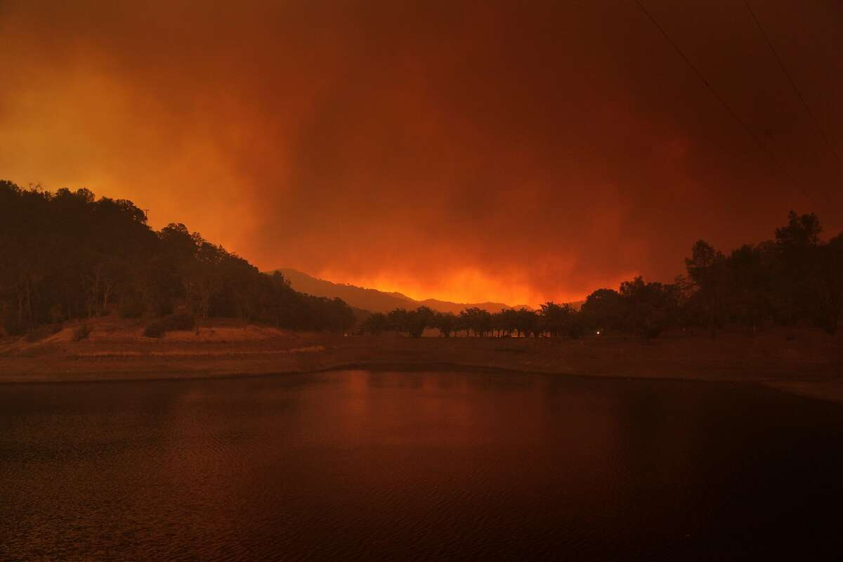The smoke darkens the sky as seen Spanish Flat Recreation Area above Lake Berryessa while the LNU Lightning Complex Fire rages near Lake Berryessa, Calif., on Tuesday, August 18, 2020.