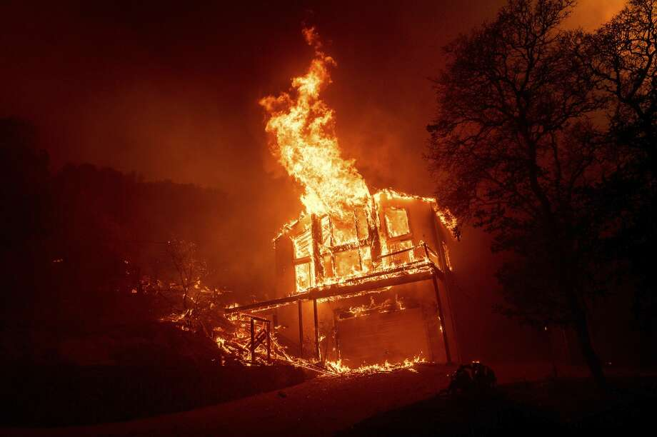 A home burns as the LNU Lightning Complex fires tear through the Spanish Flat community in unincorporated Napa County, Calif., Tuesday, Aug. 18, 2020. Photo: Noah Berger/Associated Press / Noah Berger