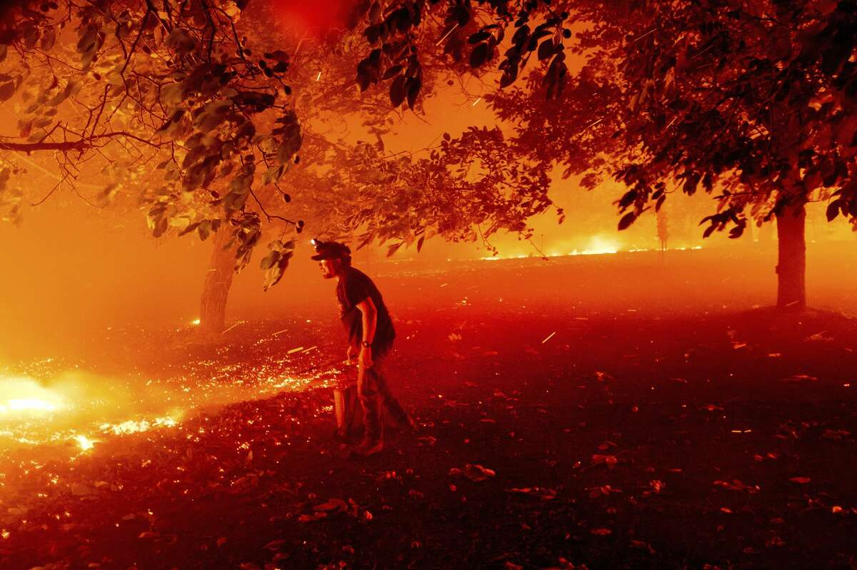 Matt Nichols tries to save his home as the LNU Lightning Complex fires tear through Vacaville, Calif., on Wednesday, Aug. 19, 2020.