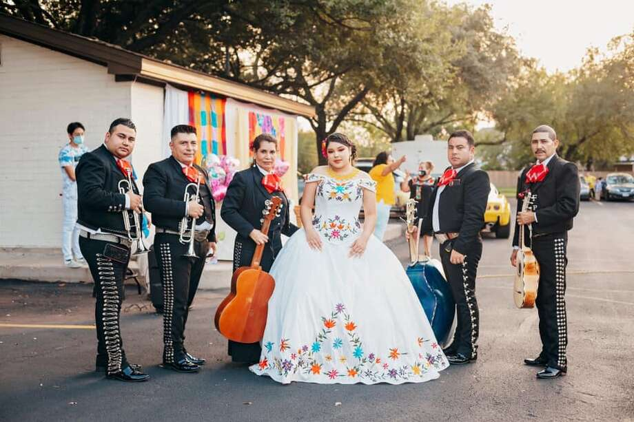 Azalia Guerrero and her family didn't let the pandemic stop them from celebrating her milestone birthday. They celebrated her socially distanced quinceañera in the parking lot of her church complete with a mariachi band. Photo: Courtesy: Ursula Williams/The Williams Studios