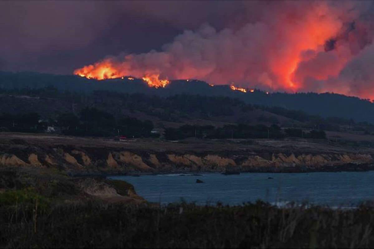 A wildfire burns near Pescadero and the San Mateo coast. It is one of the fires, known collectively as the CZU Lightning Complex Fire, that are burning in San Mateo and Santa Cruz counties.