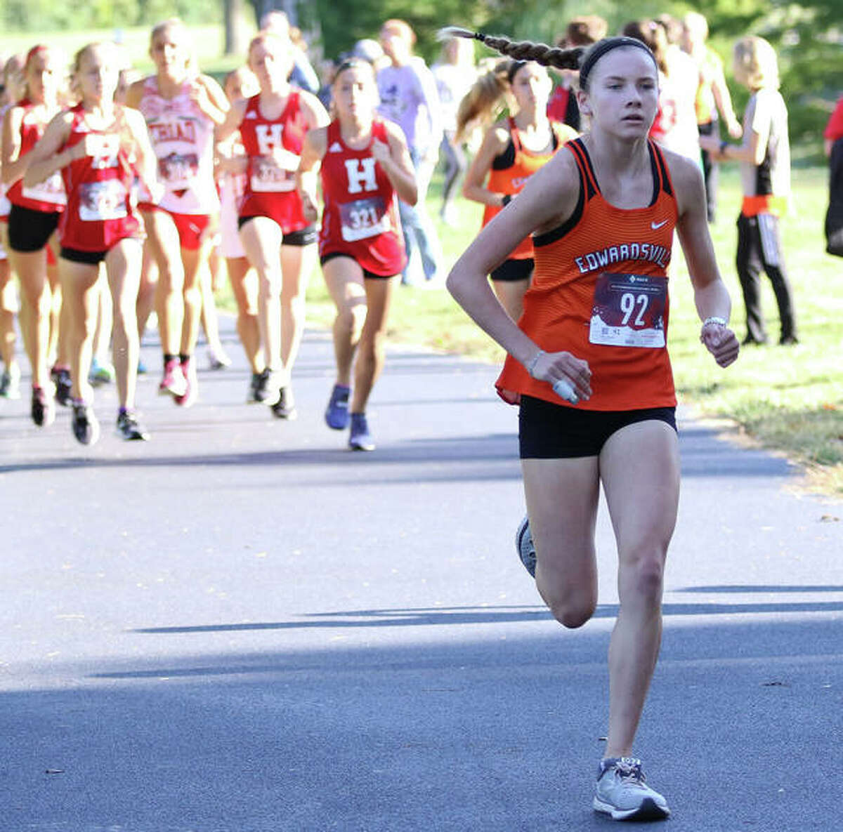 Edwardsville's Riley Knoyle pulls away from the pack on her way to a 44-second victory in the Madison County Large-Schools Meet last season at Belk Park in Wood River.
