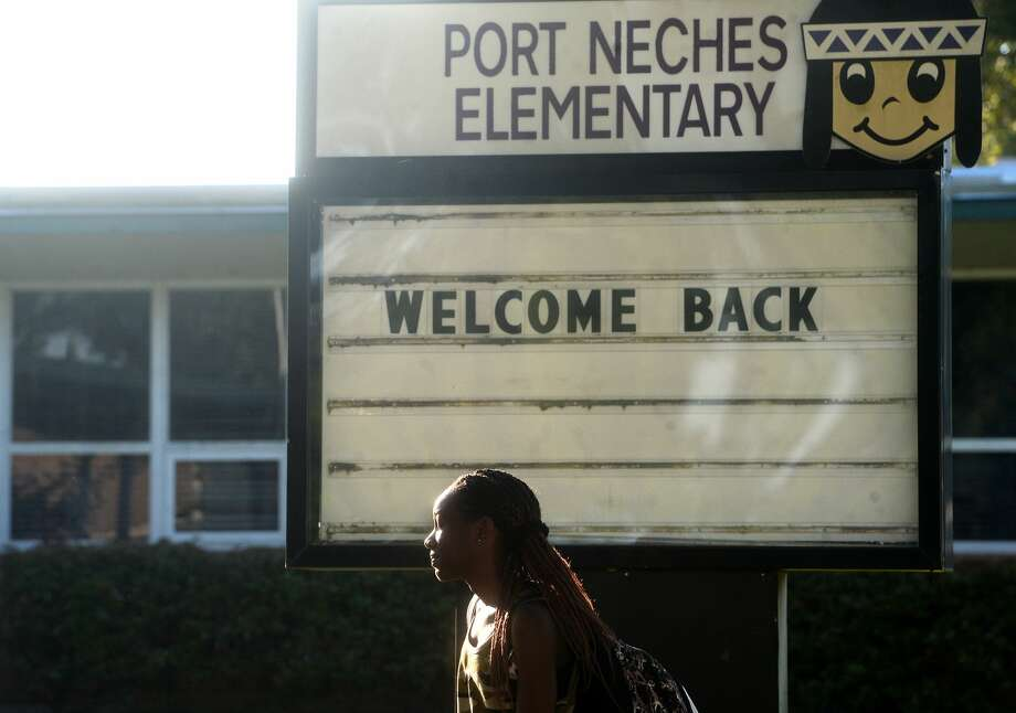 Students stop for photos as they make their way to Port Neches Elementary School Wednesday as campuses throughout the district begin the 2020-2021 academic year. Photo taken Wednesday, August 19, 2020 Kim Brent/The Enterprise Photo: Kim Brent/The Enterprise
