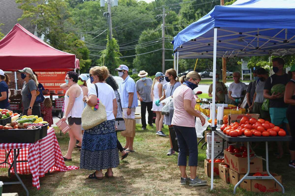 People enjoy the popular Greenfield Hill Farmer's Market on Saturday, Aug. 15, 2020, in Fairfield, Conn.