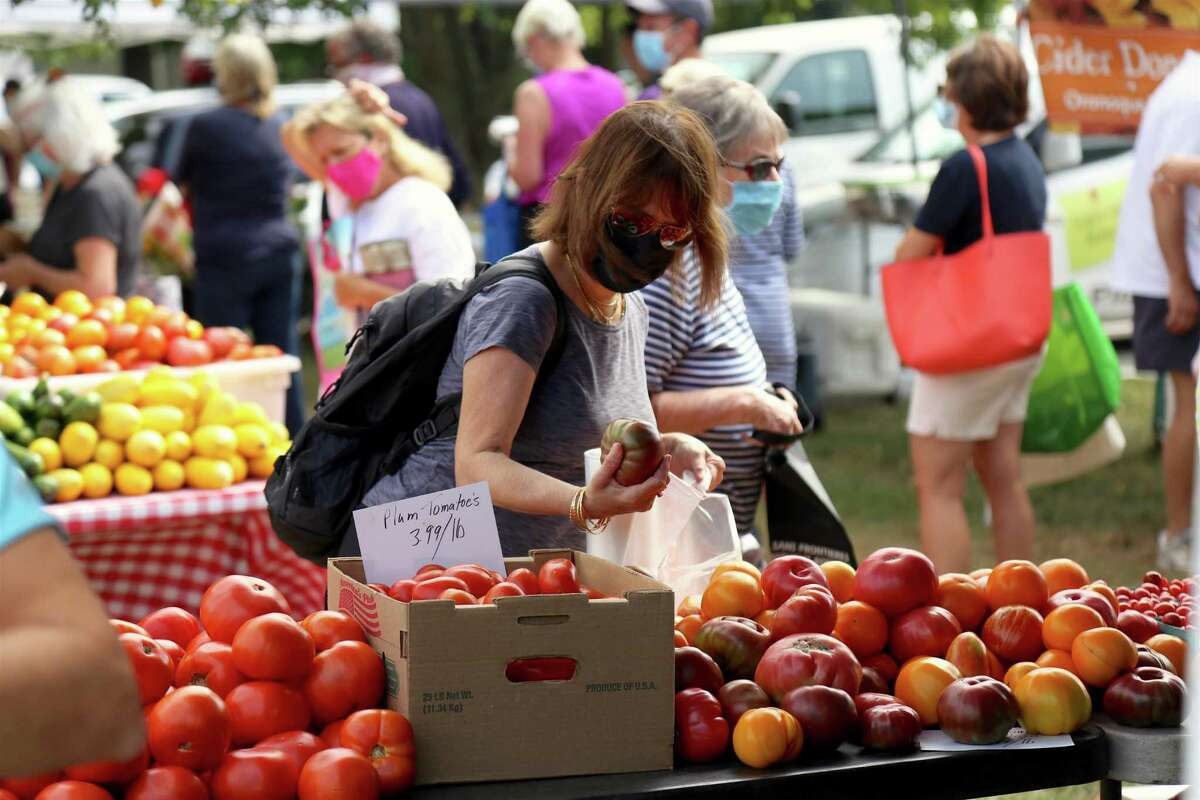 Rona Berkowitz of New York City does some shopping at Vaszauskas Farmstand at the Greenfield Hill Farmer's Market in Fairfield on Aug. 15, 2020.
