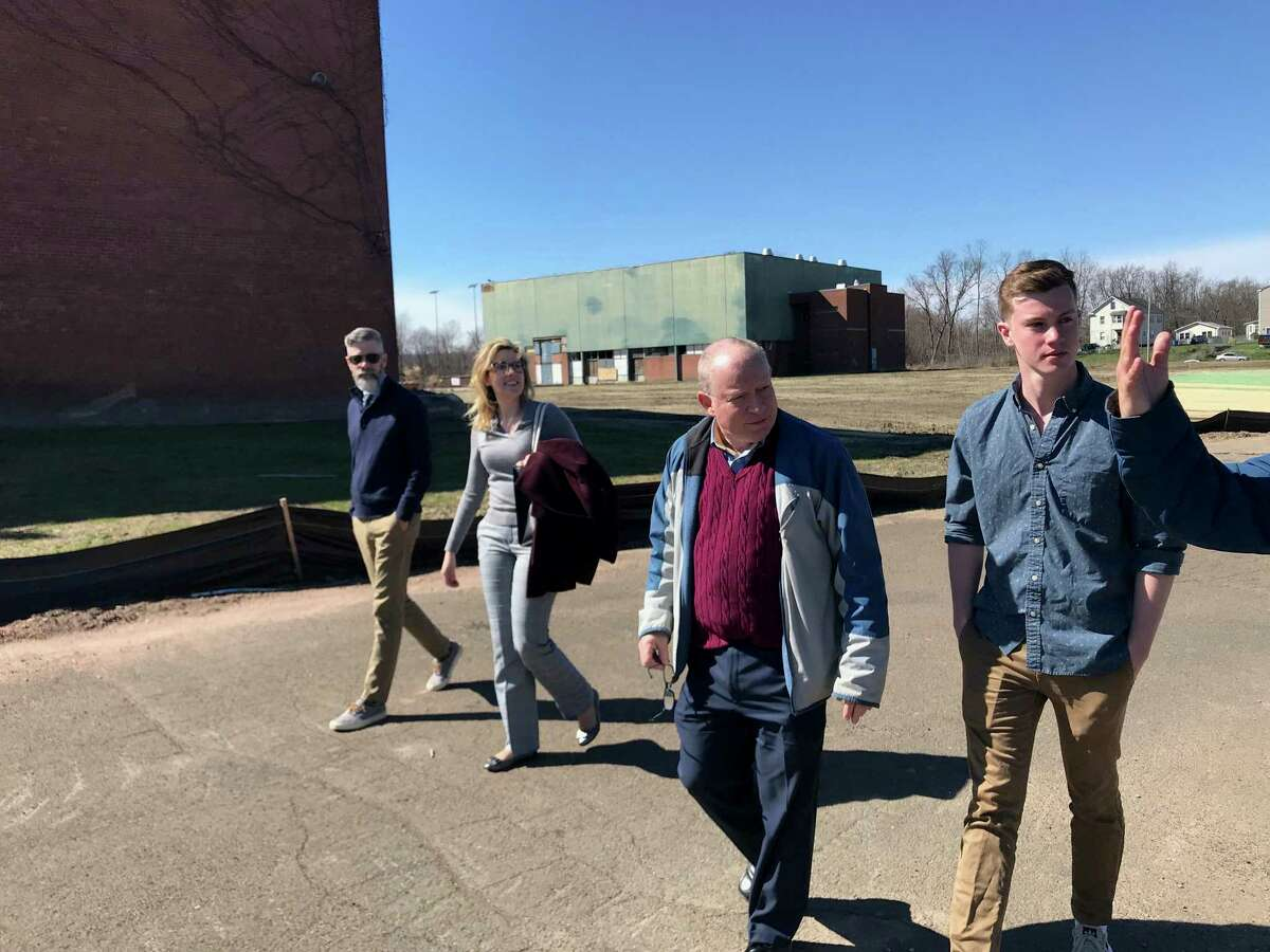 Hamden Economic Development Director Dale Kroop, second from right, tours brownfield sites with University of Connecticut students in the CT Brownfields Initiative Program, in which students and faculty at the university assist municipalities with brownfield revitalization work.