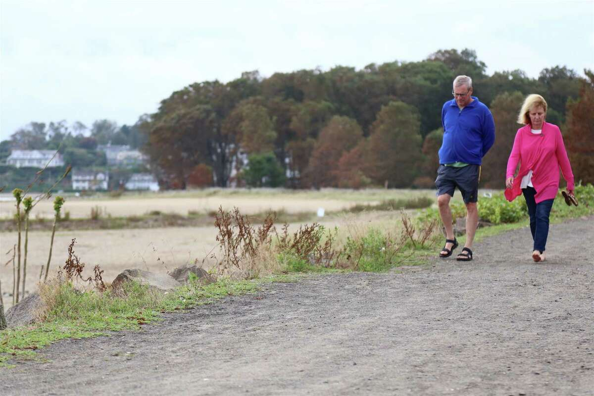 Dan and Heather Martens of Fairfield take a walk together at Sherwood Island State Park on Sunday, Aug. 16, 2020, in Westport, Conn.