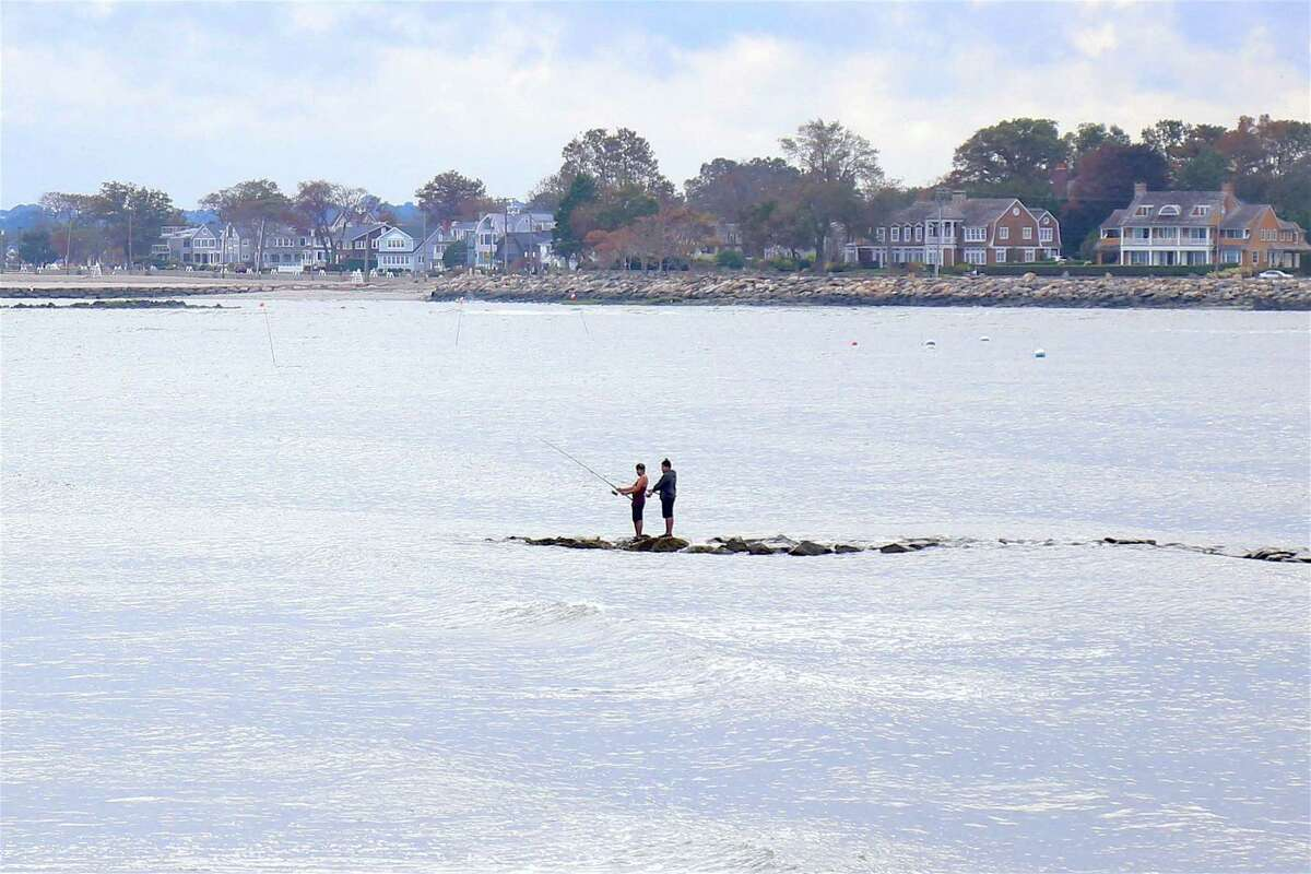 Two fishermen out on the water at Sherwood Island State Park on Sunday, Aug. 16, 2020, in Westport, Conn.