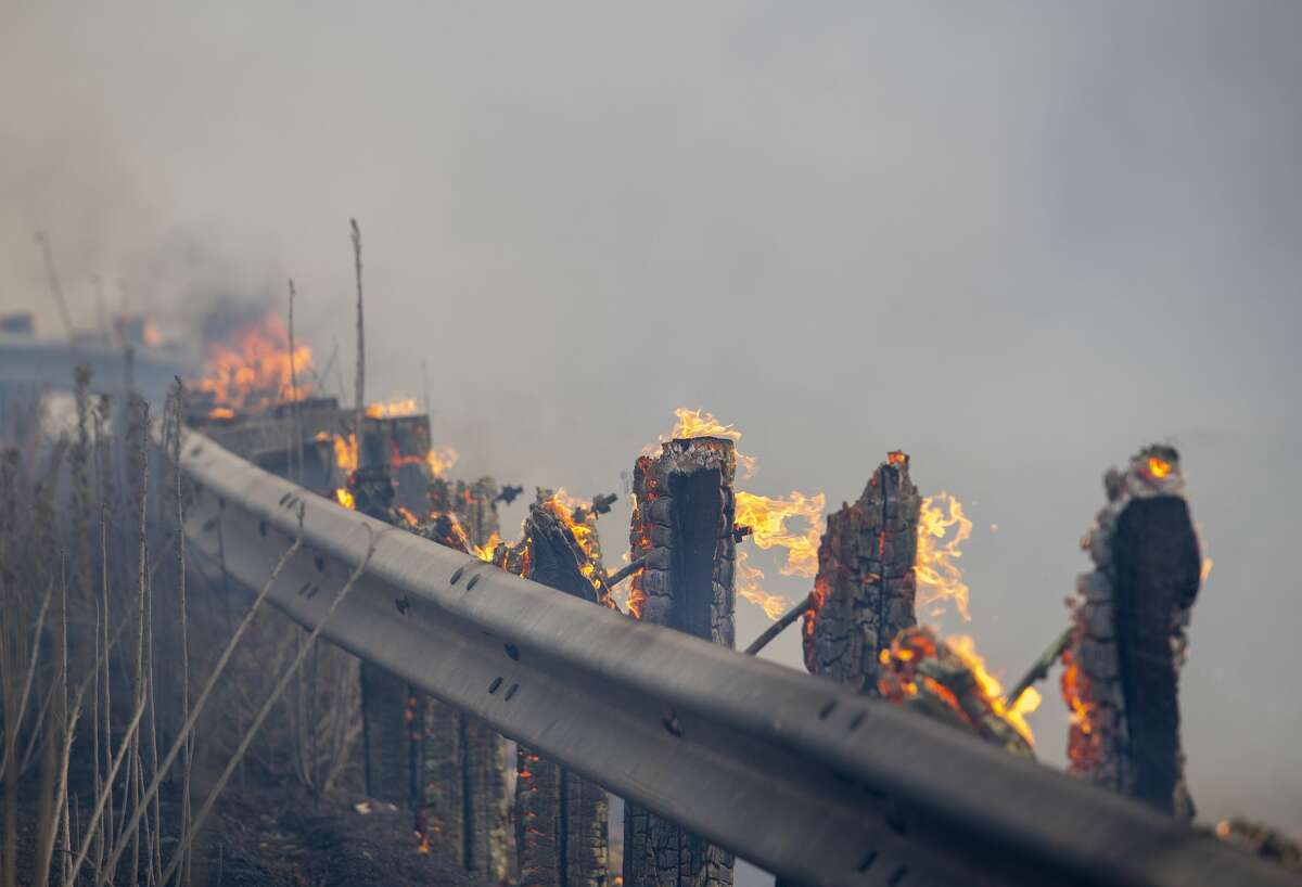 Guardrail posts burn from the Carmel Fire along Cachagua Road near Carmel Valley, Calif., Tuesday, Aug. 18, 2020.