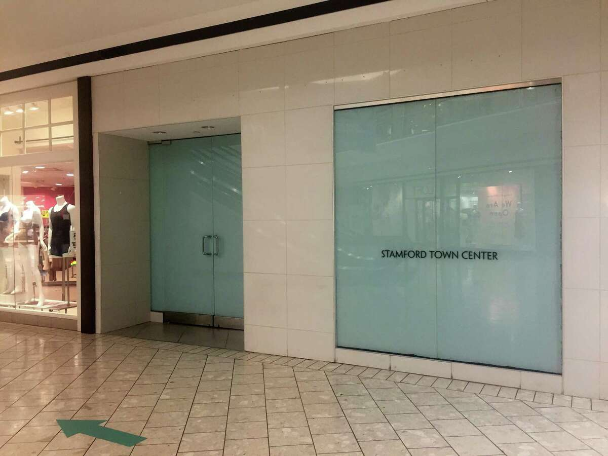 The boarded-up storefront that was formerly occupied by a GNC store on the fourth floor of Stamford Town Center mall in downtown Stamford, Conn.