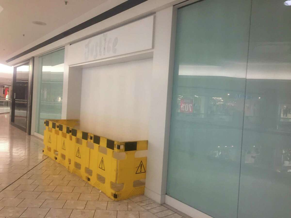 The boarded-up storefront that was formerly occupied by a Justice girls-clothing store on the fifth floor of Stamford Town Center mall in downtown Stamford, Conn.