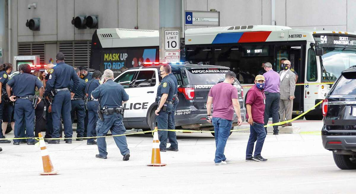 Houston police officers investigate the scene at 1900 Travis at the Metro Transit Center, after an officer involved shooting left one man dead, Tuesday, August 4, 2020, in Houston.