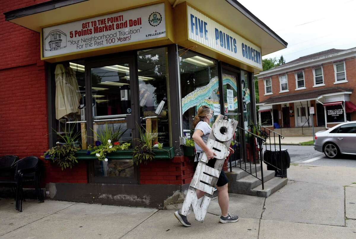 Maura Pulver closes for the day at Five Points Grocery on Wednesday, Aug. 19, 2020, in Saratoga Springs, N.Y. Pulver, who owns the business, will close the store and move into a different building nearby to continue selling food. (Will Waldron/Times Union)