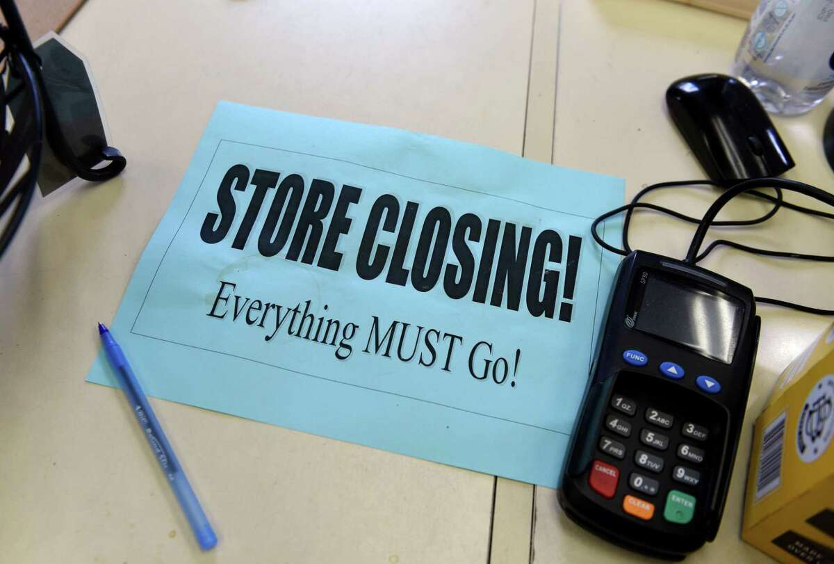 Closing signs are posted inside Five Points Grocery on Wednesday, Aug. 19, 2020, in Saratoga Springs, N.Y. Business owner Maura Pulver will close the store and move into a different building nearby to continue selling food. (Will Waldron/Times Union)