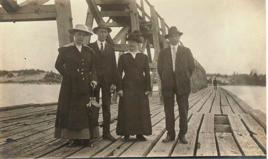 A group of visitors pose for a photo on the Manistee pier circa 1930s. (Manistee County Historical Museum photo)