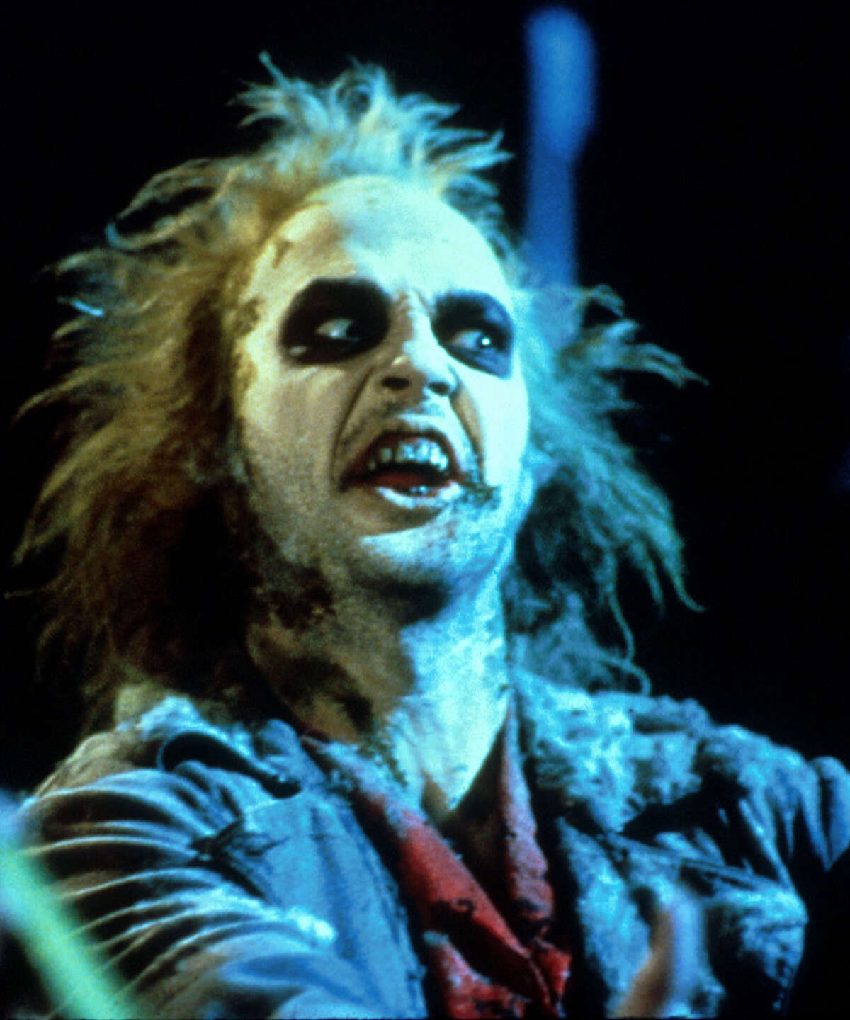A demon (Michael Keaton) having a bad hair life helps a recently deceased yuppie couple regain their home in the 1988 movie ''Beetlejuice'' Wednesday on Sci-Fi Channel.