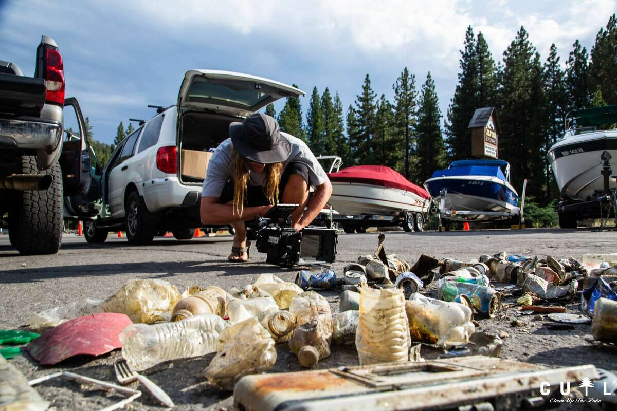 A camera crew documents trash collected by divers from beneath the surface of Lake Tahoe. Photo: Courtesy of Clean Up the Lake