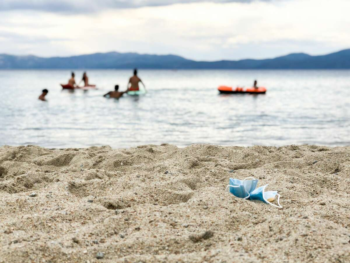 Tourists are flocking to Lake Tahoe despite the coronavirus pandemic and the wildfires.