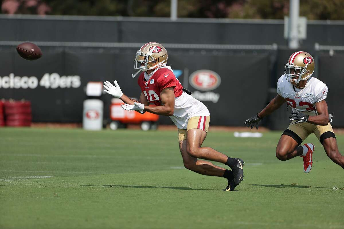 Dante Pettis makes one of his five receptions at Tuesday's training-camp practice.