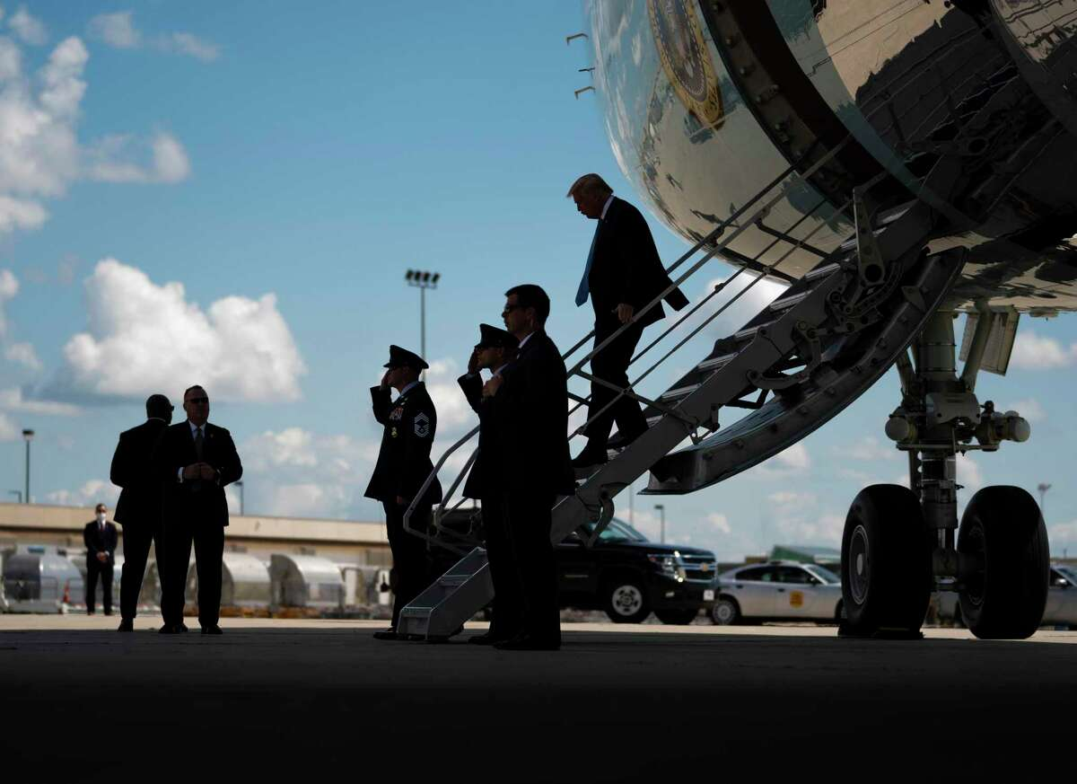 President Donald Trump departs Air Force One upon arrival in Cedar Rapids, Iowa, Tuesday, Aug. 18, 2020.