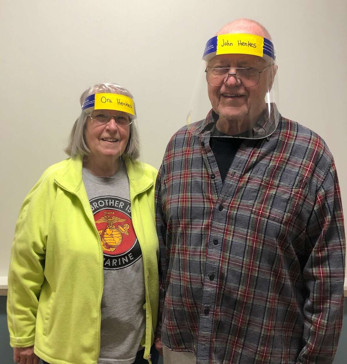 Beltrone residents Ora and John Henkes sporting their personally monogrammed Face Shields. Safe, attractive and practical. Diane Conroy LaCivita