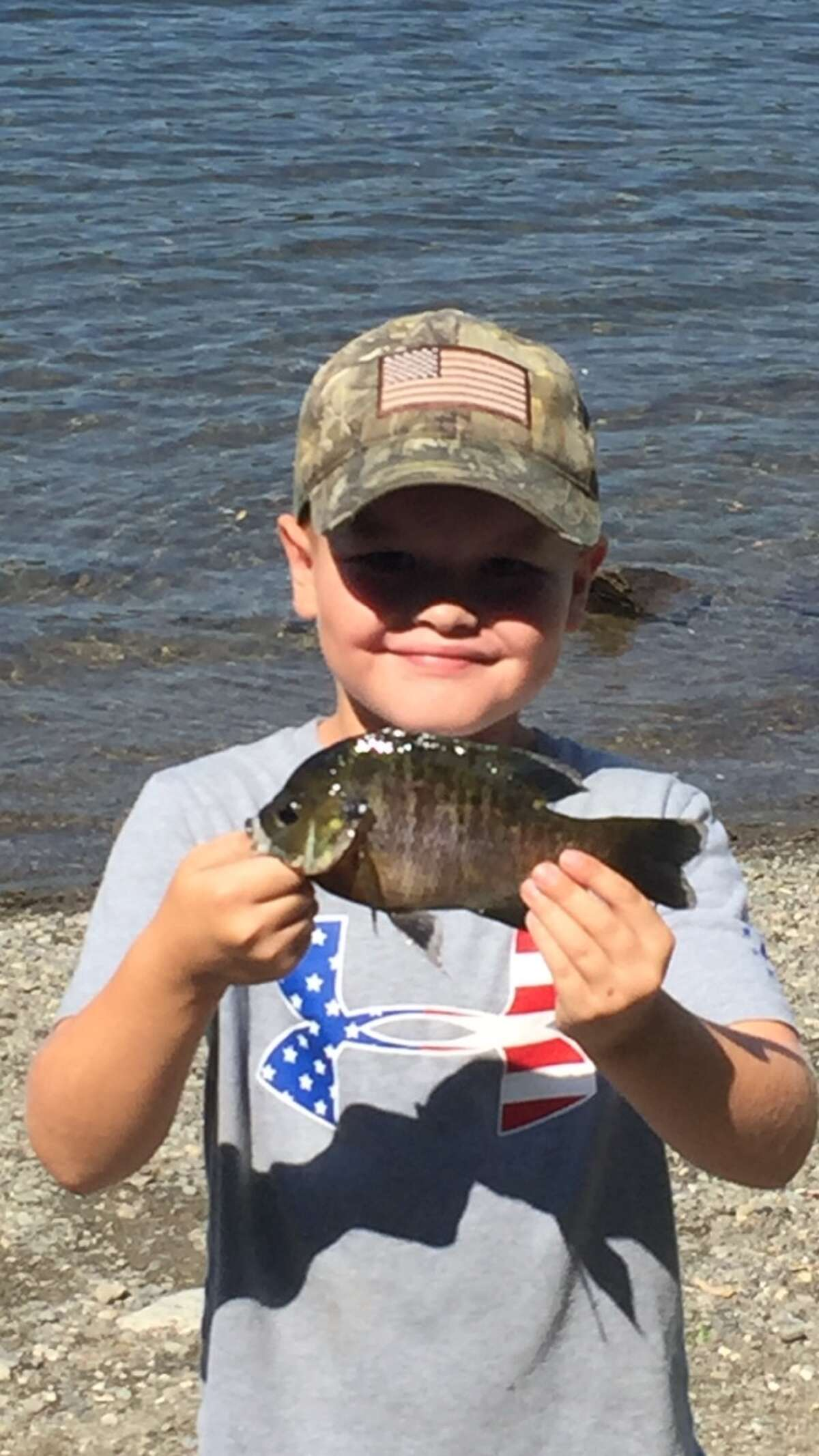 Nick Borden, 8, from Wynantskill, NY with a nice bluegill he caught in Long Pond in Grafton on Aug. 11, 2020