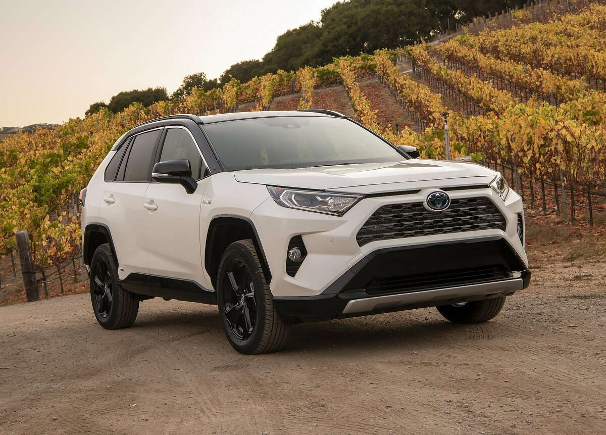 This photo provided by Toyota shows the 2020 Toyota RAV4 Hybrid. The RAV4 Hybrid is priced high enough on the used market that it's worth considering opting for new. (Courtesy of Toyota Motor Sales U.S.A. via AP)